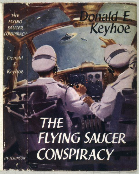 THE FLYING SAUCER CONSPIRACY, a book by Donald E Keyhoe. The cover shows two airline pilots sighting a flying saucer through their cockpit window