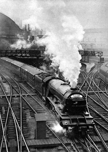 The Flying Scotsman pulling out of King's Cross station at the start of its 392 mile non-stop to Edinburgh. The journey took just under eight hours in 1933