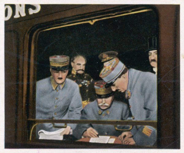 Marshall Foch studies the terms of the German surrender in a railway carriage at Compiegne