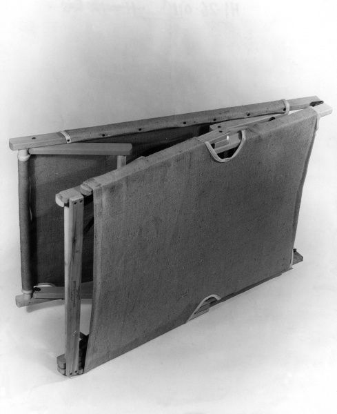 A handy folding camp bed. Date: 1930s