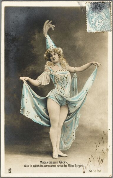A dancer from the Astronomers Revue at the Folies Bergere, Paris. The dancer is Mademoiselle Geczy, a name that hints of an Eastern European origin