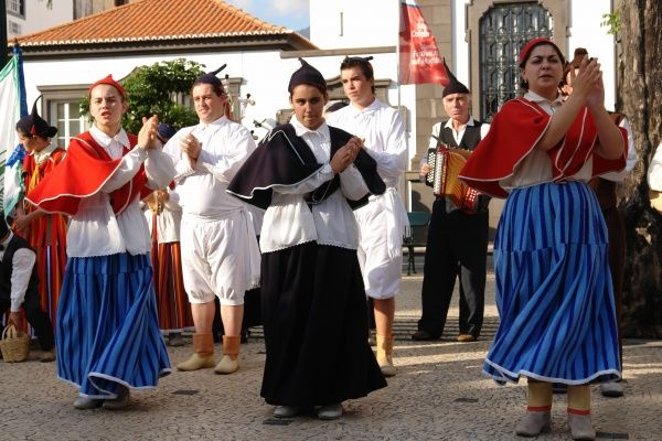 A folklore group from the village of Camacha, dancing in the street in Funchal, the capital city of Madeira
