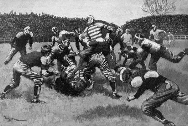The player with the ball is tackled by an opposing player, as others close in. Date: 1903