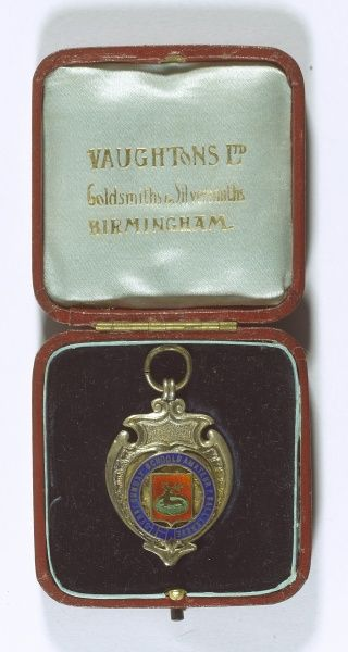 Football medal of the Derby Sunday Schools Amateur Football League, 1910-1911 season, awarded to J. H. Watson.  1911
