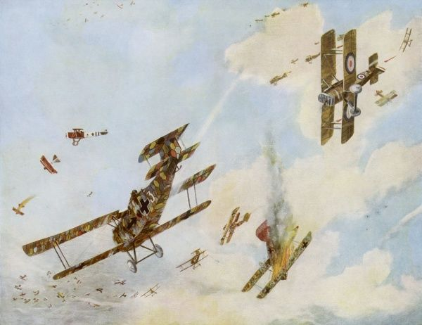 Formation fighting between German and British aeroplanes - a battle in the skies during World War One. Note the colourful paintwork of the German planes
