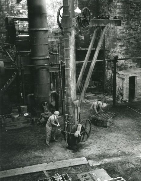 General view of the foundry at Dinorwig (or Dinorwic) Slate Quarry, near Llanberis, North Wales, with two men at work