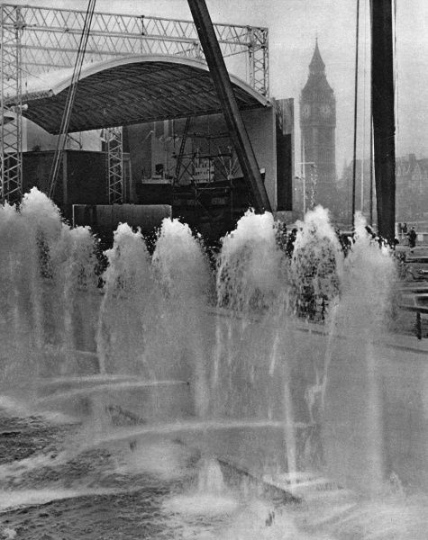 View of fountains spouting at the Festival of Britain exhibition on the South Bank, London, near the Sea and Ships Pavilion, with Big Ben in the background.  early 1951