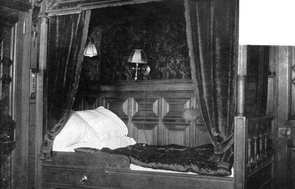 Photograph of a four poster bed in one of the first class bedrooms on the Titanic