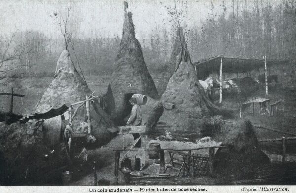 Conical mud huts in a corner of France. Captioned as huts from Sudan, this is clearly in Europe and is possibkly an exhibit (or oddity!) trying to demonstrate the form of Sudanese houses, or maybe just an illegal liquor still