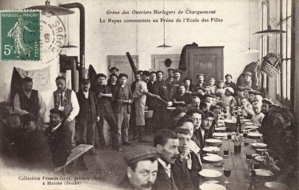 A group of striking clockmakers at Charquemont eat a communal meal at a girls school. Date: 1909