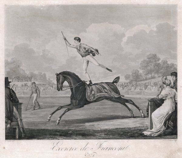 Laurent Franconi performs in Paris. Standing on one leg on the back of his black horse, he canters around the outdoor ring