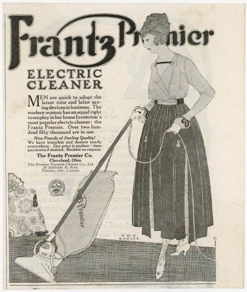 A house-proud lady vacuums her home with the Frantz Premier Electric Cleaner