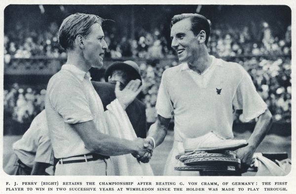 Fred Perry shaking hands with Gottfried Von Cramm of Germany, at Wimbledon after winning the championship
