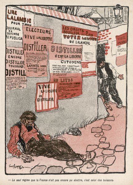 A man lies on the ground, drunk, beneath posters defending the right to distil one's own alcoholic spirits