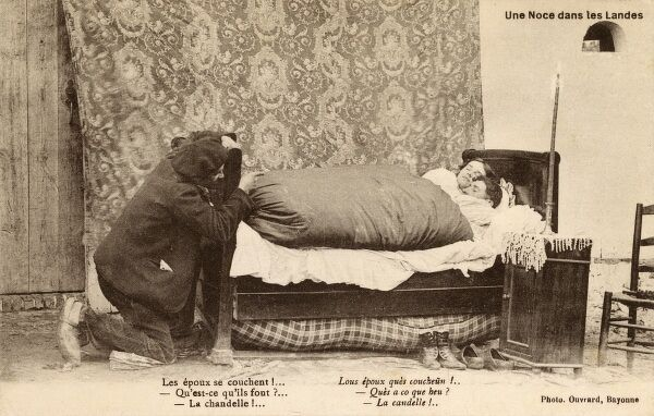 The couple go to bed! What are they doing? Date: circa 1908