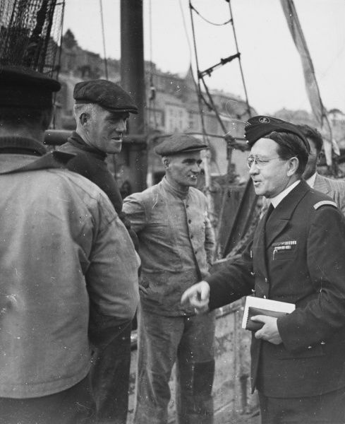 French chaplain of the Free French forces, Father Vital, with some of the French fishermen on the south coast of England
