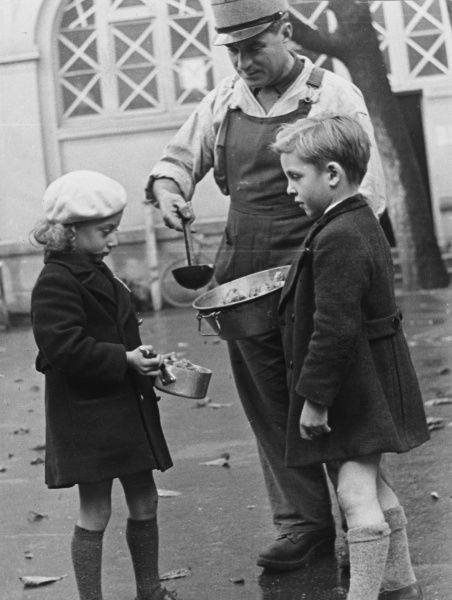 There is always some stew left over in the kitchens of the French Army and the children who have made friends with the cooks get the best of it during World War II