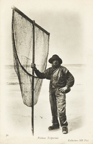 Fisherman from Treport, France, carrying a very large hand net