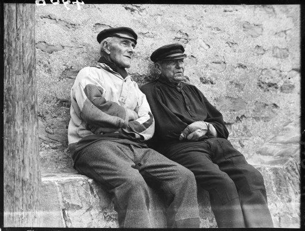 Two old French fishermen relaxing and perhaps reminiscing together
