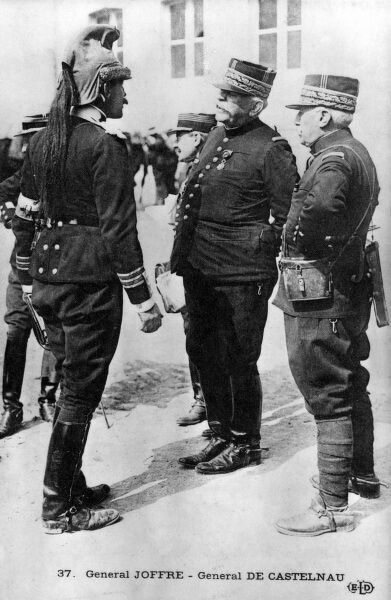French Generals Joffre (centre) and Castelnau (right), talking to a cavalry officer (left) in a cuirassier helmet on the Western Front during the First World War. Date: 1914-1918