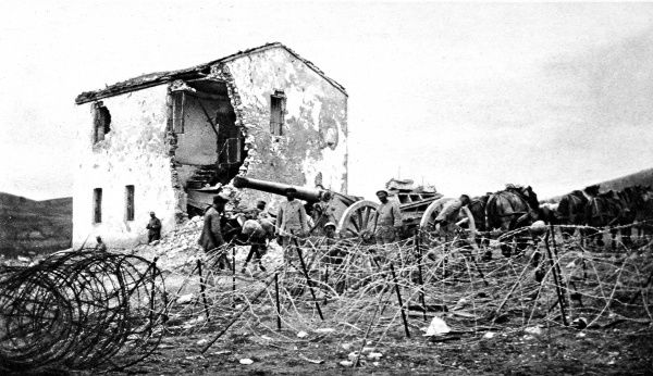 A French heavy-gun battery on the Macedonian border A French heavy-gun battery is pictured moving uphill through lines of barbed wire on the Balkan front, October 1916