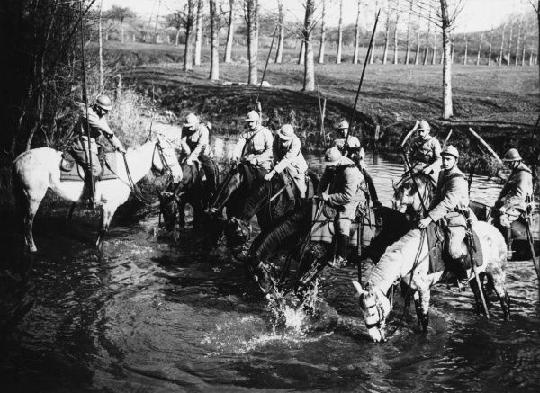 French reconnaisance patrol watering their horses at Oise on the French front during World War I in 1916