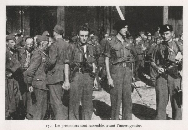 German prisoners, captured off a train by the French resisitance, are gathered together prior to interrogation. Date: circa 1944