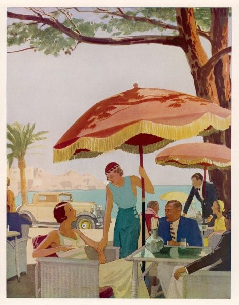Glamorous people sitting in a cafe on the French Riviera