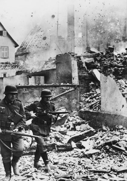 German troops in a ruined French town, France, during World War II