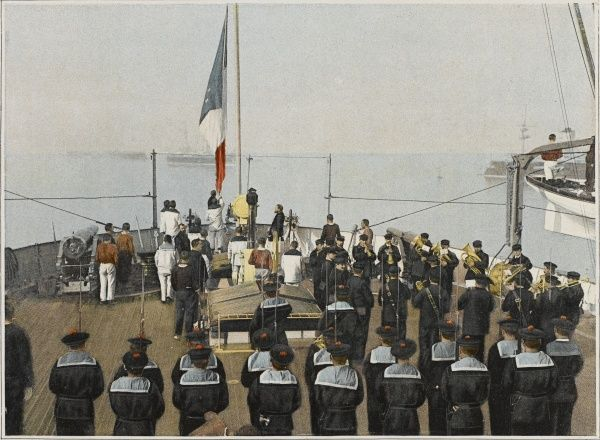French sailors salute the tricouleur as it is unfurled