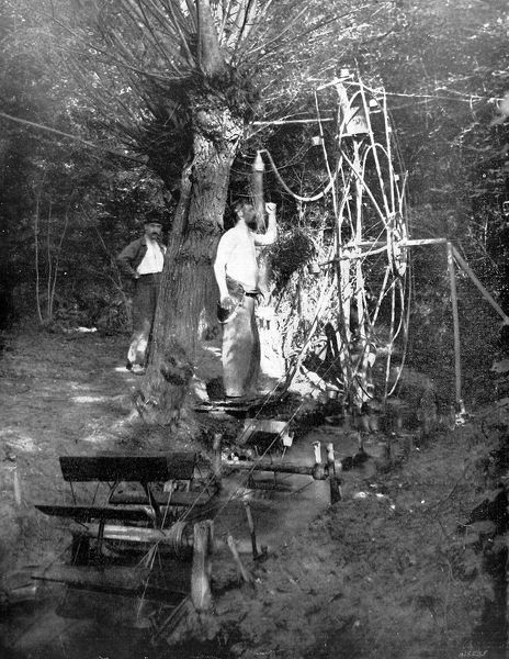 An improvised shower for French soldiers in the style of Heath Robinson, powered by a water-wheel in a small stream near the firing-line
