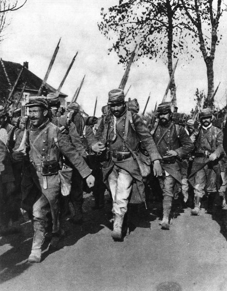 French infantrymen in their new 'tricoleur' grey uniforms, marching at a quick pace. The new grey uniform, patriotically woven of red, blue and white threads, replaced the conspicuous red and blue uniform of previous years