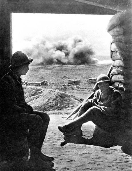 A photograph of two French soldiers taking shelter from artillery fire inside a captured German ammunition depot