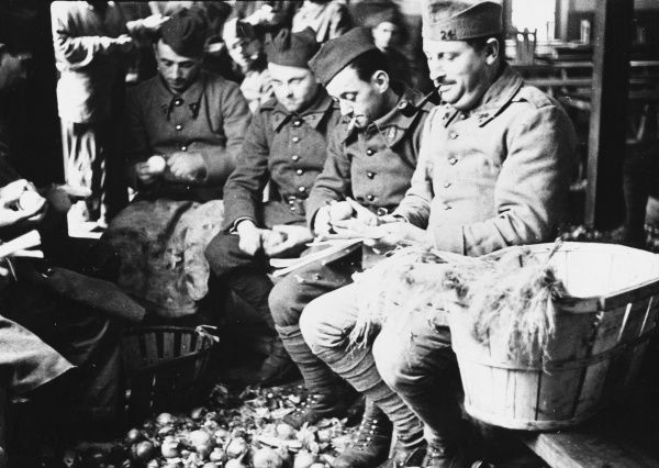 Peeling potatoes to feed the French army during World War II