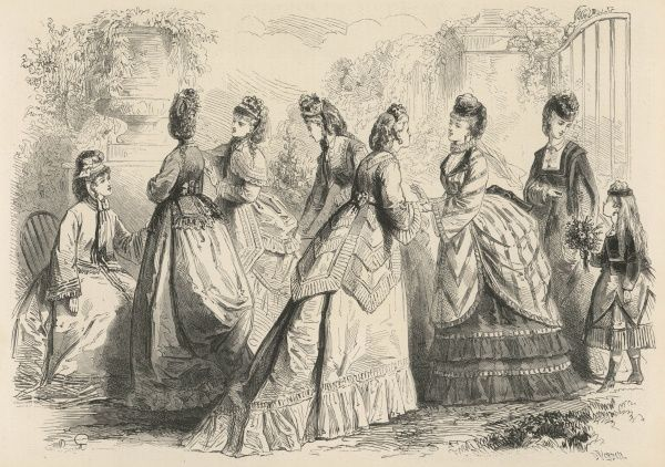 Women mingle with one another displaying the latest Spring fashions from a variety of angles