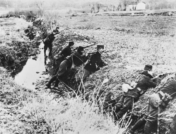 French troops manning a ditch in the Argonne District of France during World War I