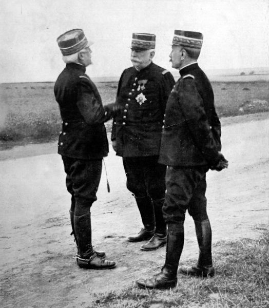 Photograph showing Generalissimo Joffre (centre), General Foch (right) and General Durbal in consultation in 1915
