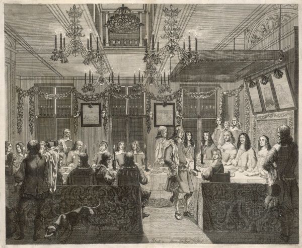 A noble family - French or Dutch - celebrate Christmas or New Year in their decorated hall : family at the head of the table, lesser mortals at the lower end
