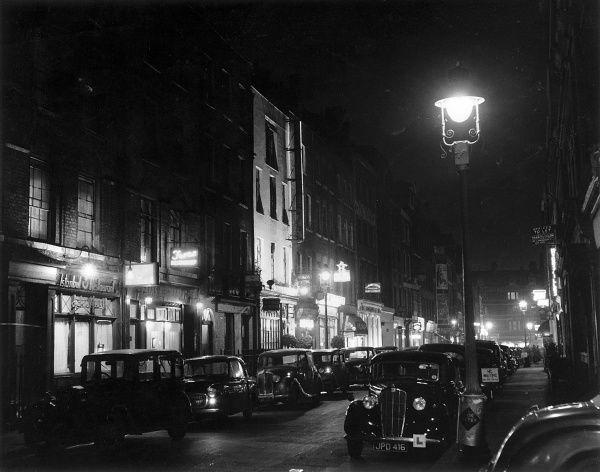 Photograph showing Frith Street, in Soho, by night c.1955