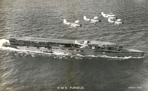 Aircraft carrier which was built during World War One and served in World War Two : she is seen here in the 1930s with a flight of Fairey Swordfish torpedo bombers Date: launched 1916