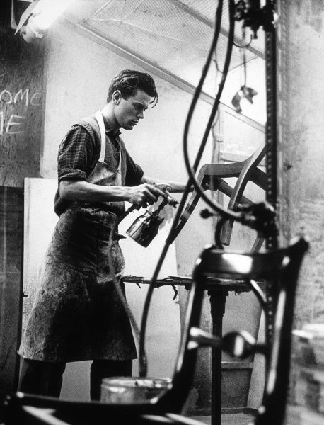 A young man working in a furniture factory, High Wycombe. Date: 1964