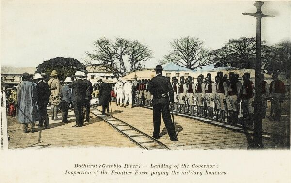 Bathurst, Gambia River - the landing of the British Governor: His inspection of the Frontier Force - who are paying the military honours