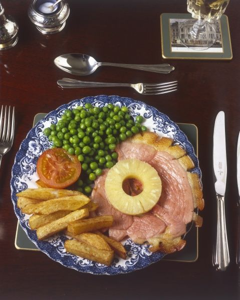 Gammon, ham, chips and peas, garnished with tomato. Date: 1980s