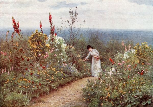 A lady in her garden at Aldworth, Surrey, in October