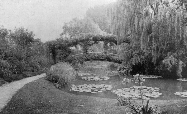 GARDEN/GIVERNY 1927. A famous view in Monet's garden, showing the lilypond and bridge