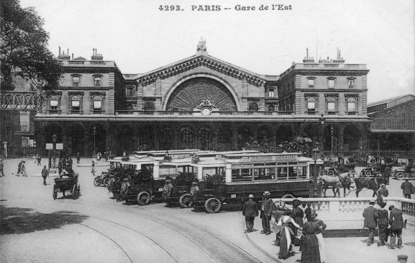 PARIS : GARE DE L'EST Motor buses line up outside the terminus, but there are still horse-drawn vehicles to be seen