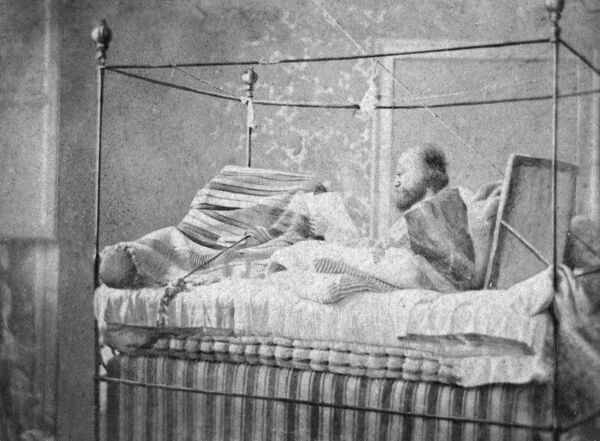 GIUSEPPE GARIBALDI Italian patriot and unifier, photographed in a four poster bed. Date: 1807 - 1882