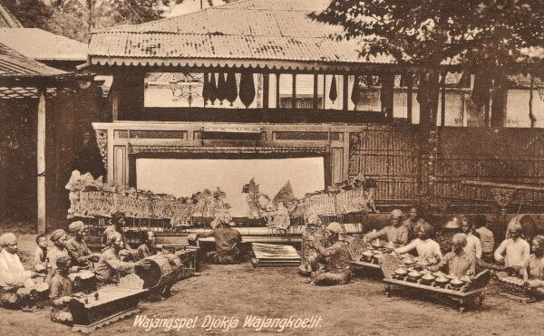 Garoet, Indonesia - Puppet Theatre and musicians forming a Gamelan orchestra Date: 1927