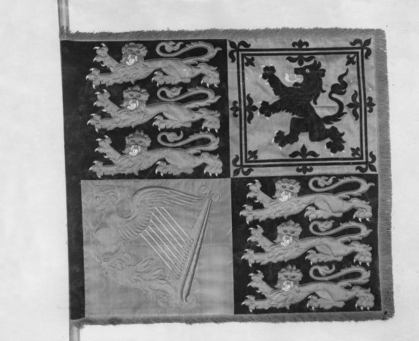 The garter banner of King George V, made at the Royal School of Art Needlework (now the Royal School of Needlework) in South Kensington, London. These banners are made when a new monarch comes to the throne, and are a centuries-old institution