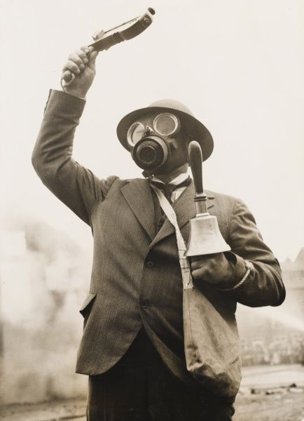 Gas attack rehearsal in Nottingham in 1938. A man with bell and rattle gives a warning of a gas attack in a simulated practice which was filmed to give instruction to other people in the UK